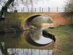 Gebogen (Merodema) Tags: bridge reflection wet water canal curves nat kanaal brug channel midlands weerspiegeling rond ronding