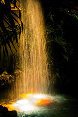 Artificial waterfall - closeup view (Victor Wong (sfe-co2)) Tags: orange white lake macro fall texture wet water fountain beauty yellow rock stone closeup night garden relax landscape flow design amber waterfall spring pond power outdoor artificial environment strong splash