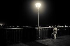 Enjoying A View (Chiradeep.) Tags: blackandwhite india monochrome night lowlight streetphotography kolkata calcutta westbengal howrahbridge