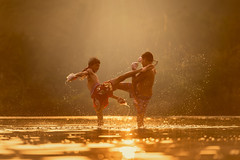 N13_8249 (Bugphai ;-)) Tags: boy sunset sky sun game male men water silhouette sport clouds training sunrise asian thailand fight asia fighter child power exercise martial kick traditional attack thai boxer punch boxing splash fitness muay knock kickboxing refection