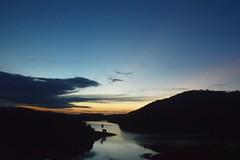 Nightfall (mara.arantes) Tags: light sunset sky cloud naturaleza mountain lake nature night digital river landscape nikon natureza silhouettes paisagem eco dike