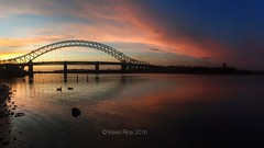 Red and yellow and pink and... (Grains of Rice) Tags: bridge sunset reflection water photoshop river sony alpha mersey runcorn runcornbridge a350 snapseed