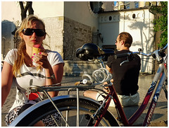 """OICU812"" - Ice cream, Main Square, Krakow, Poland (TravelsWithDan) Tags: ohiseeyouateonetoo krakow poland mainsquare oldtown icecream sunglasses bicycle prettywoman candid streetphotography"