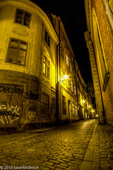 Wandering the streets of Gamla Stan #5 (sarahmcomish) Tags: old town stockholm hdr night street stone architecture perspective gamla stan alley cobbles graffiti