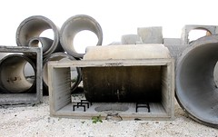 Bivalve, NJ (elisecavicchi) Tags: cement pipe tube segment shape abstract sculpture pile stack part climb fitted lot bivalve fishing village storage outdoor light new jersey autumn fall october raw edges glow port norris commercial township