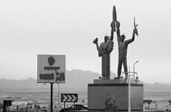 Ironic Peace (DrowsyShutter) Tags: egypt hurghada peace ak47 monochrome irony blackwhite nikon d3300