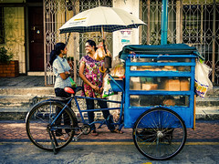 Bread Cart (saltycdogg) Tags: morning blue girls india smiling umbrella bread early town george pretty little georgetown cycle malaysia penang cart