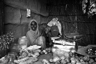 A Somali woman runs a small grocery shop.