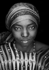 Mrs Madina, Afar Tribe Woman, Assayta, Ethiopia (Eric Lafforgue) Tags: africa portrait people blackandwhite eye beauty smile smiling vertical female scarf outdoors women day african headscarf lifestyle tribal beautifulwoman sha