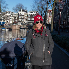 Barb walking down the straat in Amsterdam (www.higbyphotography.com) Tags: christmas vacation sunlight holland reflection water netherlands amsterdam boats photographer tourist straat sshadows canalsbikes princengratch