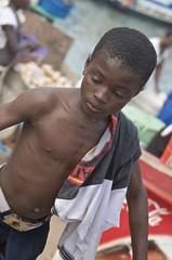 boy cleaned up after fishing (Pejasar) Tags: africa boy shirtless wet climb torso fishingvillage elmina ghanawestafrica