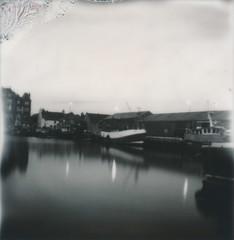 pier polaroid II (ingrid_b21) Tags: longexposure blackandwhite bw film water polaroid pier orkney harbour pinhole instant kirkwall waterreflection impossibleproject impossibleblackandwhite600film