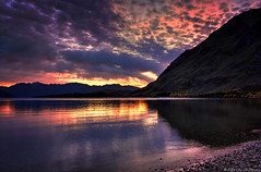 Morning Sun Lightshow (Kevin_Jeffries) Tags: new morning autumn sunset sea newzealand panorama cloud mountain lake colour reflection nature water silhouette sunrise landscape fire golden interesting flickr natur wideangle southisland redsky lightshow wanaka 18mm jeffries flickrtoday southernlakes glendhubay kevinjeffries