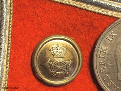 Button with coin - for Macro Mondays (Finn Frode (DK)) Tags: denmark coin uniform indoor button hmm postman 1963 5kr macromondays frederikiv smallerthanacoin posttelegrafvsenet