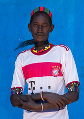 Portrait of a hamer tribe man with bayern munich football shirt, Omo valley, Turmi, Ethiopia (Eric Lafforgue) Tags: africa portrait people color men vertical shirt outdoors photography necklace football colorful day adult african culture tribal teenager blackpeople omovalley ethiopia tribe ethnic tmobile oneperson hamer hornofafrica ethnology eastafrica bayernmunich abyssinia tribesman onepersononly realpeople blackskin lookingatcamera onemanonly waistup turmi africanethnicity 1people indigenousculture ethnicgroup oneadult blackethnicity modernityandtradition ethiopianethnicity giraffehair ethio161560