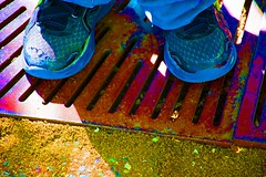 Kid on a grate at Abq BioPark (cshubs) Tags: blue red color colors outdoors gold kid shoes child infocus highquality