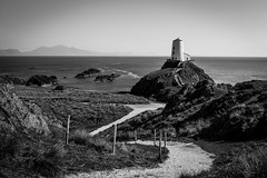 Llanddwyn lighthouse (Explored) (Sandy Sharples) Tags: blackandwhite lighthouse history monochrome wales landscape path national trust llanddwyn anglesey