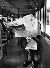 Hong Kong 1986 (Dizzy Atmosphere) Tags: hongkong china hongkongtrams publictransit newspaper trampassengers tram olympusxa kodaktrix