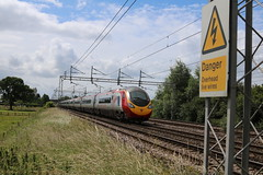 Virgin 390002 passes Coppenhall - Crewe (uksean13) Tags: train canon cheshire transport rail railway virgin crewe pendolino ef28135mmf3556isusm coppenhall 390002 760d