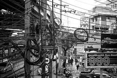 telecommunications thai style (The Cassandra Project) Tags: travel thailand reisen wiring chaos bangkok cables thai messy reportage chaotic verkabelung telecommunications reisefotografie installationstechnik verdrahtung