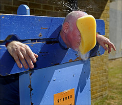 100710.016. 'Splatt Adian'.  (THDS100710garlinge-8.) (actionsnaps) Tags: man water kent adult spray stocks familyfun splash captive highstreet fundraising throwing baldhead thanet restrained redface charityevent communityevent pillory garlinge directhit policecommunitysupportofficer kentpolice wetsponges garlingeresidentsassaciationsummerfair garlingemethodistchurch splattadrian fullintheface pcsoadrianbutterworth