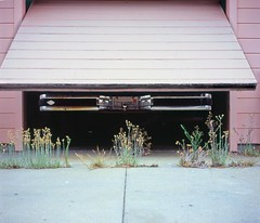 Garage door reveal (ADMurr) Tags: california door film rollei monterey weeds kodak garage overcast pickup crop opening 6x7 ektar