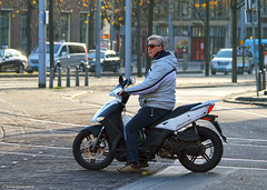 The Need For Speed (Rick & Bart) Tags: city people man male guy candid transport thenetherlands strangers streetphotography scooter denhaag menschen agility thehague personnes mensen everydaypeople vreemden rickbart rickvink