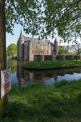 Slot Zuylen, Oud-Zuilen (natures-pencil) Tags: building tree brick water netherlands grass leaves sign architecture reflections tile utrecht nederland foliage moat turrets manorhouse