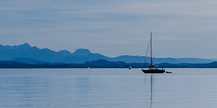 Very quiet, warm and sunny (hjuengst) Tags: blue panorama lake mountains alps sailboat geotagged boot see boat silent peaceful calm berge chiemsee ruhe chieming bavariansea