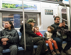 Subway Scene (UrbanphotoZ) Tags: city nyc newyorkcity bridge woman ny newyork train river subway poster manhattan father daughter mother son stranger midtown smartphone engaged bucolic distracted trepidation