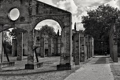 I resist! (henryark) Tags: blackandwhite monochrome monoart columns architecture arches outdoor perspective clouds sky bricks rusty iron enrico nannini henryark nikon nikond750 row shadows street route grass park furnace pontedera tuscany italy building temple windows circles stones dirty restored rundown sunny light trees lines parallel industrial archeology factory walls