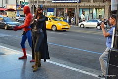 Spiderman and Catwoman posing for a photo (elnina999) Tags: california road street city travel girls urban usa cinema cars film tourism strange movie person star fan town costume los fantastic funny boulevard crossing dress angeles walk character lifestyle pedestrian tourist clothes odd hollywood disguise curious crosswalk imaginary fictional antagonist d5100