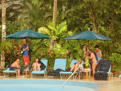Scramble for cover (oobwoodman) Tags: pool rain hotel pluie resort swimmingpool tropical caribbean stlucia regen rendezvous piscine westindies schwimmbad tropisch tropique