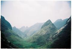 (tayn3) Tags: summer mountains green film analog 35mm landscape haze nikon scenery dramatic vietnam 35mmfilm 100 f3 analogue hazy cinematic karst nikonf3 ektar 100iso filmphotography hagiang northvietnam kodakektar dongvan ektar100 dongvanloop