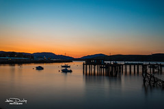 Gourock Harbour (Alan Dunlop Photography) Tags: longexposure blue sunset summer sky sun abandoned water beautiful yellow skyline river landscape outside golden scotland riverclyde greenock pier boat scenery colours view unitedkingdom outdoor scenic hills gourock inverclyde renfrewshire