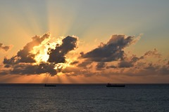 Ships and Sky (ChristopherSmith.Photo) Tags: ocean light sea sky sol sunshine clouds sunrise golden boat skies ship bright horizon silhouettes calm atlantic rays sunrays supershot