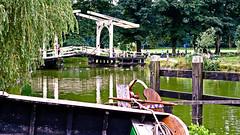 Openlucht museum  (1918) - Arnhem (Eduard van Bergen) Tags: old bridge trees holland water netherlands dutch field sign museum vintage boat ancient alt arnhem nederland mooring brug paysbas oud 1939 openlucht 1918 niederlande toen vroeger ouderkerkaandeamstel