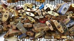 Jumble of padlocks, a.k.a. cadenas or lovelocks, Paris (Monceau) Tags: bridge paris seine pedestrian padlocks passerelle solfrino