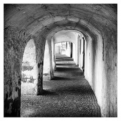 The Tunnel (:: Blende 22 ::) Tags: blackandwhite italy white black monochrome wall blackwhite tunnel citywall southtyrol festung glurns efs1855mmf3556 wehrgang einfarbig schwarzweis canon400d canoneos400ddigital