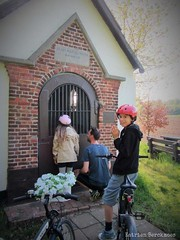 with the help of jesus, maria and joseph (katrienberckmoes) Tags: father daughter praying for good cycling tour neighbourhood laughing brother chapel wijnegem belgium