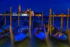 View of gondolas and the Church of San Giorgio Maggiore across the Venice lagoon (diana_robinson) Tags: bluehour gondolas churchofsangiorgiomaggiore venicelagoon venice italy nightphotography longexposure abigfave