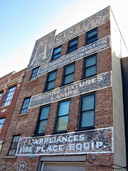 Meginniss Electric, Albany, NY (Robby Virus) Tags: albany newyork state meginniss electric electrical supplies building ghost sign signage ad advertisement wall lighting fixtures lamps appliances fire place equipment largest finest selection
