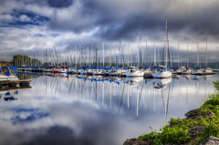 Lake City Marina (John D. Stocker) Tags: city morning lake reflection water glass minnesota clouds sailboat marina docks john river mississippi boats boat dock sailing calm reflect shore sail sailboats mn pepin stocker wwwpaintedspurphotographycom paintedspur