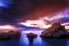 Purple sundown (ilias varelas) Tags: longexposure blue light sunset sea sky sun sunlight seascape motion beach water canon landscape rocks colours purple sundown greece ilias canonef1740mmf4l varelas canoneos6d