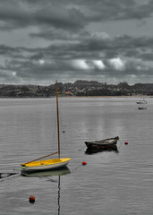 evening calm and yellow selection (AlberBarrera) Tags: ocean sunset sea summer sky bw reflection yellow clouds port landscape grey evening monocromo harbor boat fishing spain ship softness calm galicia edition dramaticsky seashore navigate colorselection