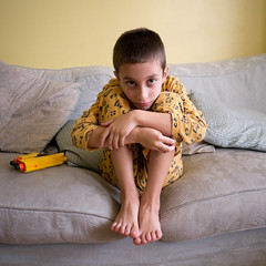 Leopard boy (SouthallAddick) Tags: boy portrait haircut yellow toes sofa nerf hunched gx7