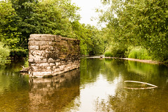 River Exe near Brampford Speke, just outside Exeter (Keith in Exeter) Tags: reflection tree archaeology water stone river landscape industrial crossing outdoor railway exeter vegetation disused column brampfordspeke wooded exe