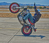 Biker wheelie and no hands (atitsince82) Tags: show california family boy red summer portrait people usa men art boys up bike bar speed america train landscape handle photography us high amazing lift bright artistic action body smoke rear wheels fast tire front double burn american hero biker brake handlebar practice spark tumble hdr tyre stunt wheelie skid role nohands stunts hollister liftup bodydouble boytoys