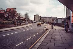 Paisley High Street. (ianrwmccracken) Tags: film 35mm canon lens march scotland 28mm slide positive 29 paisley 1985 highstreet kodachrome64 fd ae1program