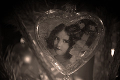 ۰۰Christmas brings me a sense of nostalgia that makes me feel sadly happy and, at the same time, happily sad!۰۰ (Ranveig Marie Photography) Tags: gray grey svarthvitt sorthvitt svartkvitt vintage girl kid photo heart ornament christmas christmastree child bauble baubles bokeh tree branch jul xmas december juletre season noel kersfees christusfees jol рождествохристово bożenarodzenie vánoce navidad høytid holidays weihnachten jól jõulud kerstmis natal crăciun vianoce 圣诞 圣诞节 聖誕節 ziemassvētki smile pine macrolife images pictures photos juletrekule blackandwhite bw bnw ranveigmarienesse ranveignesse pics photographs bilder photography
